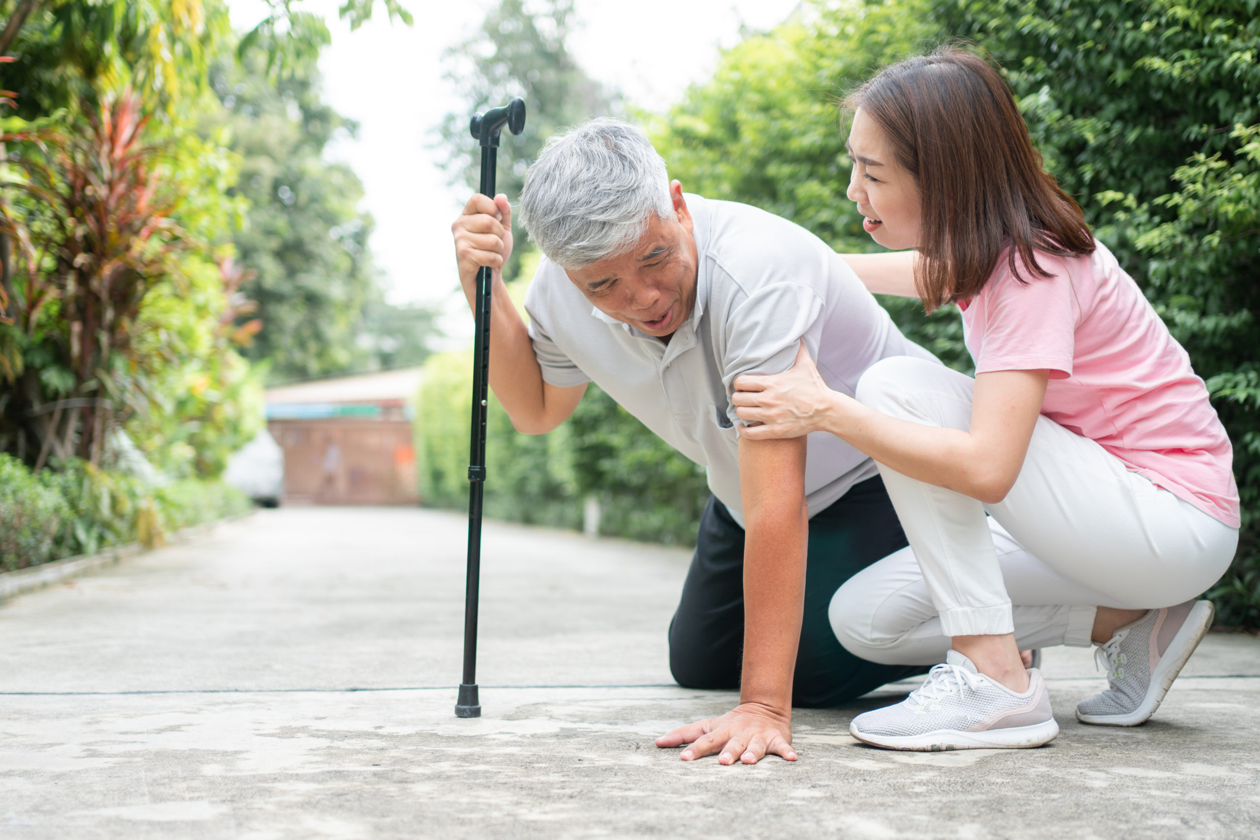 Asian Senior Man Falling Down At Home In The Backyard Caused By Myasthenia (muscle Weakness) And The Nurse Came To Help Support. Concept Of Old Elderly Insurance And Health Care