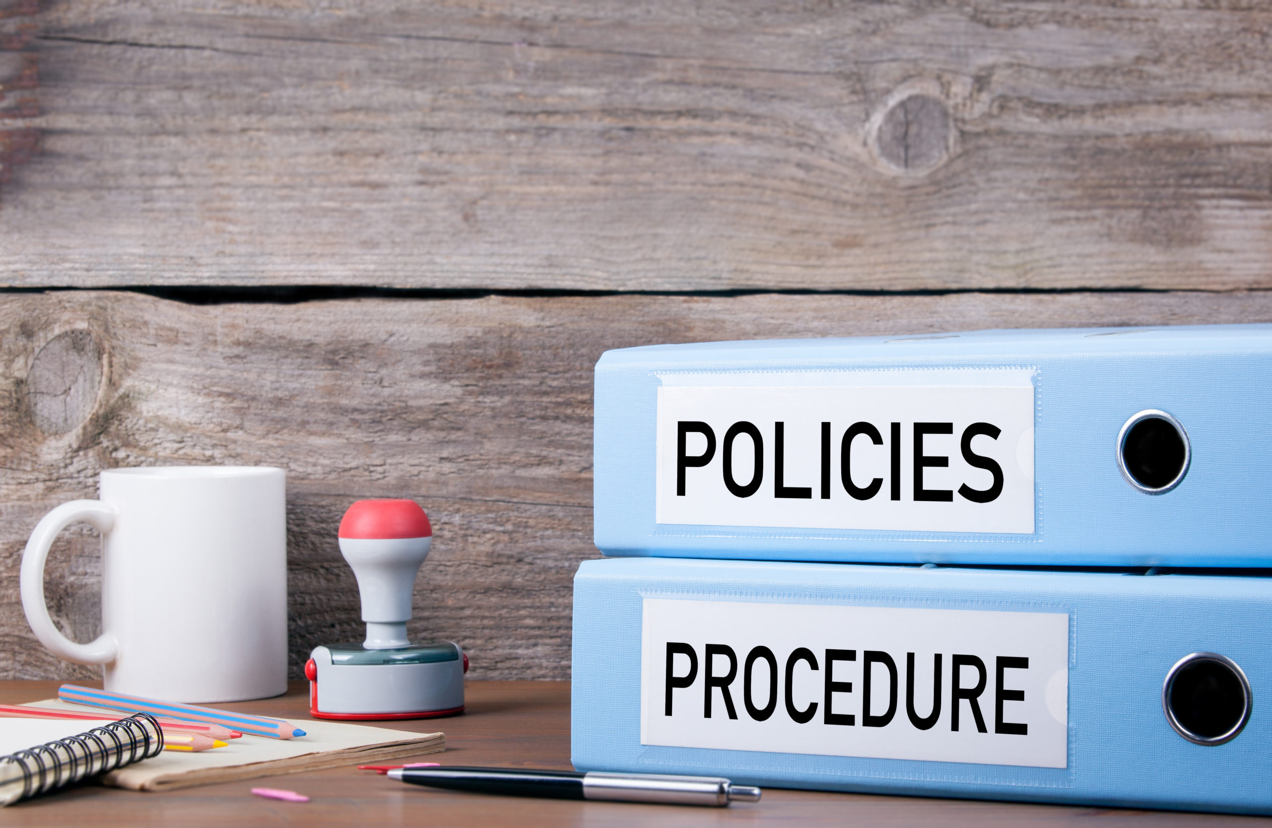 Policies And Procedure. Two Binders On Desk In The Office. Busin